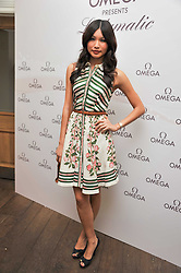 GEMMA CHAN at a pool party to celebrate the UK launch of the Omega Ladymatic Collection held at the Haymarket Hotel, Haymarket, London on 16th June 2011.