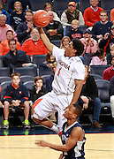 CHARLOTTESVILLE, VA- December 3: Jontel Evans #1 of the Virginia Cavaliers shoots over a Longwood Lancer defender during the game on December 27, 2011 against the Longwood Lancers at the John Paul Jones Arena in Charlottesville, Virginia. Virginia defeated Longwood 86-53. (Photo by Andrew Shurtleff/Getty Images) *** Local Caption *** Jontel Evans