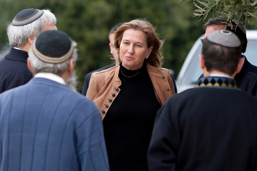 Israel's opposition leader Tzipi Livni (C), is welcomed by Jewish Rabbis, heads of the Har Etzion Yeshiva in the Jewish settlement of Alon Shvut during her tour of Gush Etzion on January 16, 2011.