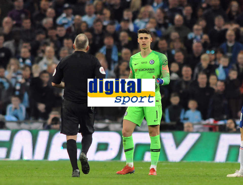 Football - 2019 EFL League Cup Final (Carabao Cup) - Manchester City vs. Chelsea<br /> <br /> Chelsea Goalkeeper, Kepa Arrizabalaga tells referee Jon Moss that he does'nt want to come off after substitute keeper, Willy Caballero was waiting to come on, at Wembley Stadium.<br /> <br /> COLORSPORT/ANDREW COWIE