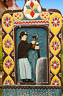 Tombstone showing a miner in a mine, The  Merry Cemetery ( Cimitirul Vesel ),  Săpânţa, Maramares, Northern Transylvania, Romania.  The naive folk art style of the tombstones created by woodcarver  Stan Ioan Pătraş (1909 - 1977) who created in his lifetime over 700 colourfully painted wooden tombstones with small relief portrait carvings of the deceased or with scenes depicting them at work or play or surprisingly showing the violent accident that killed them. Each tombstone has an inscription about the person, sometimes a light hearted  limerick in Romanian. .<br /> <br /> Visit our ROMANIA HISTORIC PLACXES PHOTO COLLECTIONS for more photos to download or buy as wall art prints https://funkystock.photoshelter.com/gallery-collection/Pictures-Images-of-Romania-Photos-of-Romanian-Historic-Landmark-Sites/C00001TITiQwAdS8