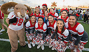 Former US Olympic gymnast Mary Lou Retton poses for a photograph with Waltrip High School cheerleaders before the Wounded Warrior Amputee Football Team game against NFL Alumni, at Delmar Stadium, February 1, 2017.