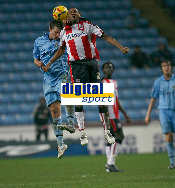 Coventry's Stephen Hughes (left) and Southampton's Alaxander Ostlund (right) contest the ball