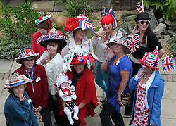 © Licensed to London News Pictures. 04/06/2012. Reading, Berkshire. The ladies of Shepherds Lane show off their hats at a garden party to celebrate The Queen's Diamond Jubilee. Photo credit : Rebecca Mckevitt/LNP