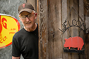 Bob Denman of Red Pig Tools in the door of his store.