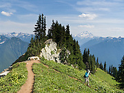 Glacier Peak is seen from the Green Mountain trail in Mount Baker-Snoqualmie National Forest, accessible from the Mountain Loop Highway, Washington, USA. Glacier Peak, which rises to elevation 10,541 feet in Glacier Peak Wilderness, is the most isolated of the five major stratovolcanoes (composite volcanoes) of the Cascade Volcanic Arc in Washington. Glacier Peak formed during the Pleistocene epoch (about 1 million years ago) and is one of the most active of Washington's volcanoes, erupting explosively five times in the past 3,000 years.