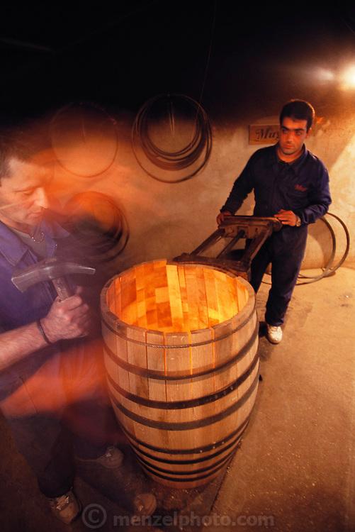 Coopers making wine barrels at Bodegas Muga in Haro, Rioja, Spain.