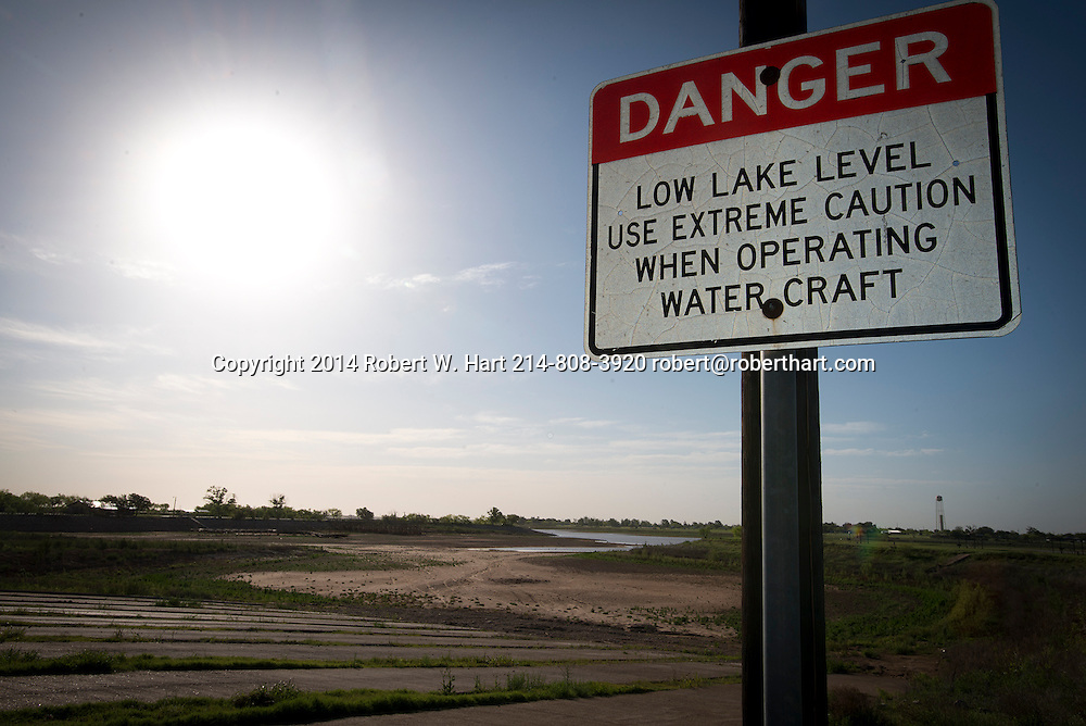 A sign at a Lake Arrowhead boat ramp warns boaters to beware of the low water level. However, the boat ramp has been useless for months since the ever-receding lake is more than 100 yards in the distance. Lake Arrowhead State park is just south of Wichita Falls, Texas and the lake supplies the town with drinking water.