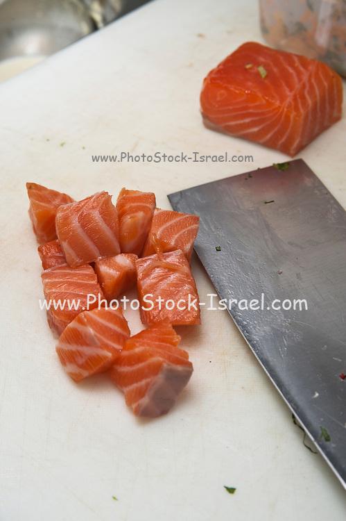 Restaurant's kitchen Cut cubes of fresh raw salmon