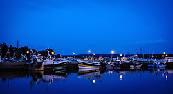 Fishing boats tied up in the harbour in Honfleur, Normandy, France in the evening
