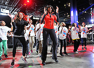 """First Lady Michelle Obama dances with Chicago students at her """"Bringing Physical Activity Back to Schools"""" event at McCormick Place in Chicago on February 28, 2013. Obama held her event in Chicago to celebrate the third anniversary of her """"Let's Move"""" anti-obesity program.  (UPI)"""
