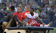 Aug 25, 2017; Seattle, WA, USA; Kansas City Chiefs running back Spencer Ware (32) is taken off the field with an injury during a NFL football game against the Seattle Seahawks at CenturyLink Field.