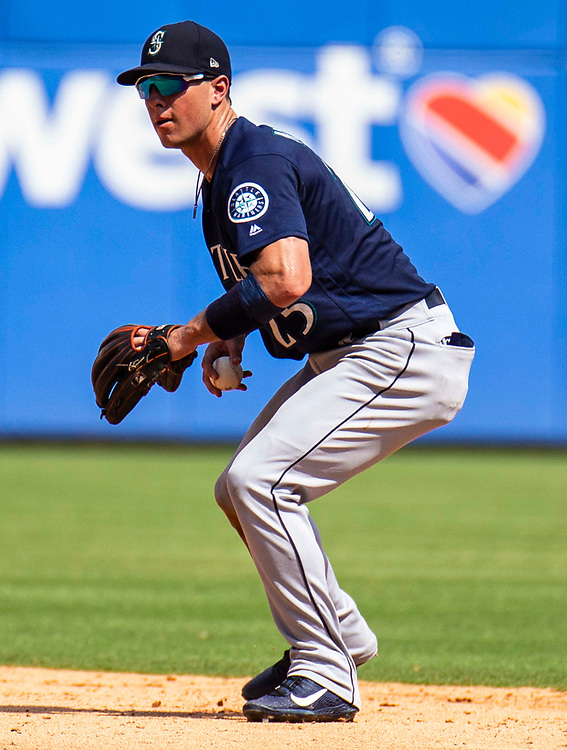 Aug 01 2019, Arlington, TX  U.S.A. Seattle shortstop Dylan Moore (25) makes an infield play during the MLB game between the Seattle Mariners and the Texas Rangers 11-3 win at Globe Life Park in Arlington,TX. Thurman James / CSM