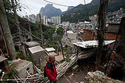 Rocinha is the largest favela in South America, located in the wealthy south zone of Rio Janeiro, it is often referred to as a city within a city. Situated directly in between the three wealthiest neighbourhoods in the city, in parts it has spectacular views. During the UPP pacification programme, it did receive a Police station, but this is one of the places that the program has been met with skepticism, drug dealing continues, in some areas young men on the street are armed, and there are sometimes shootouts. Seen here is the water system, consisting of lots of tiny, outdated pipes, providing the water that many rely on every day.