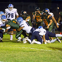 Wingate Bears junior Tyreke Harvey runs for a short gain through the middle. Wingate High School faced off against Window Rock High School at home in Fort Wingate, NM.
