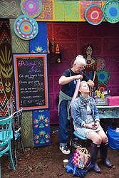 Latitude Festival, Henham Park, Suffolk, UK July 2019. Hair braiding