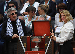 British Musician Roger Waters (L) and French actress Lea Seydoux (R) present the men's trophy Coupe des Mousquetaires prior the final match at the French Open tennis tournament at Roland Garros Stadium in Paris, France on June 10, 2018. Photo Photo by
