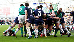 Ireland's Sean Cronin (bottom left) scores his side's fourth try during the NatWest Six Nations match at the Aviva Stadium, Dublin.