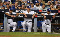 October 24, 2017 - Los Angeles, California, U.S. - Los Angeles Dodgers manager Dave Roberts, left. along with bench coach Bob Geren and quality assurance coach Juan Castro (13) in the eighth inning of game one of a World Series baseball game against the Houston Astros at Dodger Stadium on Tuesday, Oct. 24, 2017 in Los Angeles. Dodgers won 3-1. (Photo by Keith Birmingham, Pasadena Star-News/SCNG) (Credit Image: © San Gabriel Valley Tribune via ZUMA Wire)
