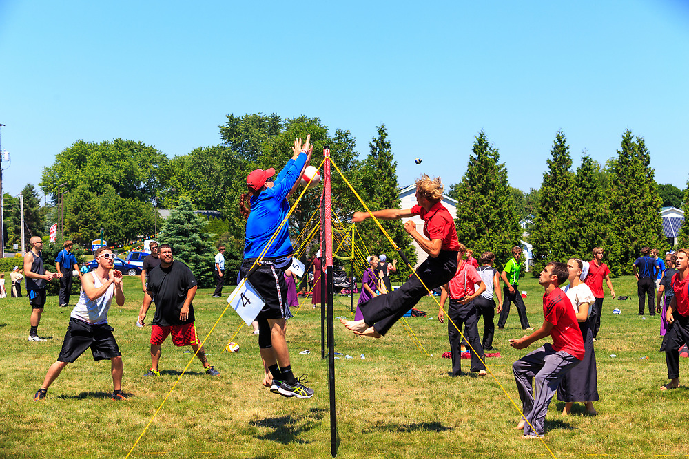Intercourse, PA - June 18, 2016: Old Order Amish youths play volleyball with non-Amish teenagers at a community park.