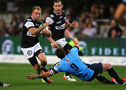 Hanco Venter of the Sharks is tackled by Piet van Zyl during the Currie Cup match between the The Sharks and The Blue Bulls held at King's Park, Durban, South Africa on the 27th August 2016<br /> <br /> Photo by:   Anesh Debiky / Real Time Images