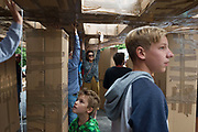 21/07/2018 repro free:  <br /> The People Build at Galway International Arts Festival saw not just one but two large-scale structures appear in a matter of hours built solely from cardboard. Under the guidance of French artist, Olivier Grossetete and his team, The People Build saw over 600 volunteers and members of the general public transform cardboard boxes into a church steeple and a bridge. This spectacular architectural event won the hearts of festival audiences and encouraged a sense of community where everyone could get involved. The structure built at Eyre Square was inspired by St. Nicholas' Church in Galway and the bridge at Waterside was positioned at the location of Galway's River Corrib Viaduct, once part of the famous Galway to Clifden Railway.<br /> <br /> It is estimated that almost 4 tonnes of cardboard were used across the two builds. Following the constructions, children and grown-ups alike joined forces in a massive celebratory demolition, which saw the cardboard structures come tumbling down amidst shrieks of joy and delight.<br /> <br /> Walsh Waste & Recycling have once again joined forces with Galway International Arts Festival to ensure there was no unnecessary waste following the event and were on hand to take away the crushed cardboard to be recycled. Photo:Andrew Downes, xposure