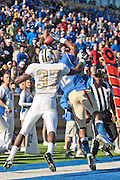 Nov 17, 2012; Tulsa, OK, USA; Tulsa Hurricanes wide receiver Jordan James (12) pulls down a touchdown catch over University of Central Florida Knights defensive back Brandon Alexander (37) during a game at Skelly Field at H.A. Chapman Stadium. The play was called back for a penalty and Tulsa defeated UCF 23-21.Mandatory Credit: Beth Hall-US PRESSWIRE