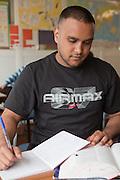 A prisoner doing written work during a lesson. HMP The Mount, Bovingdon, Hertfordshire