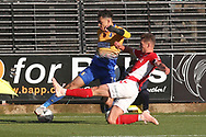 Toby Stevenson of Charlton Athletic (43) blocks a cross from Tyler Walker of Mansfield Town (19) during the The FA Cup match between Mansfield Town and Charlton Athletic at the One Call Stadium, Mansfield, England on 11 November 2018.