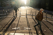 With most Londoners still working from home, a few commuters walk around the widened corner of Threadneedle and Old Board Streets at evening rush-hour during the third lockdown of the Coronavirus in the City of London, the capitals financial district, on 26th February 2021, in London, England.