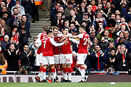 Aaron Ramsey of Arsenal (c) celebrates with his team mates after he scores his team's second goal. Premier league match, Arsenal v Swansea city at the Emirates Stadium in London on Saturday 28th October 2017.<br /> pic by Steffan Bowen, Andrew Orchard sports photography.