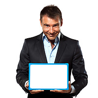 one caucasian business man holding showing whiteboard in studio isolated on white background