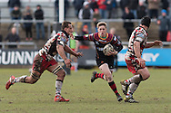 Angus O'Brien of the Newport Gwent Dragons sees a gap between Anton Bresler (L) and Alasdair Dickinson (R) of Edinburgh rugby. Guinness Pro12 rugby match, Newport Gwent Dragons v Edinburgh Rugby at Rodney Parade in Newport, South Wales on Sunday 27th March 2016.<br /> pic by  Simon Latham, Andrew Orchard sports photography.