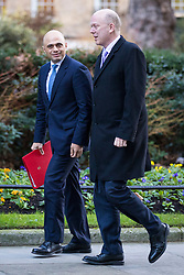 © Licensed to London News Pictures. 16/01/2018. London, UK. Secretary of State for Housing, Communities and Local Government Sajid Javid (L) and Transport Secretary Chris Grayling (R) arrive on Downing Street for the weekly Cabinet meeting. Photo credit: Rob Pinney/LNP