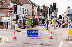 © Licensed to London News Pictures. 18/06/2015. Watord, Hertfordshire, UK. The city centre of Watford is brought to a standstill as roads are cordoned off amidst reports of the discovery of a suspect package in Market Street, which was detonated by the bomb disposal unit and the subseqent arrest of a person dressed in a burkha, today, the first day of the Muslim festival of Ramadan. Photo credit : Stephen Chung/LNP