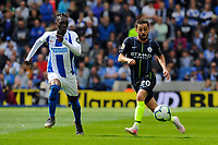 BRIGHTON, ENGLAND - MAY 12:  Bernardo Silva (20) of Manchester City on the attack chased by Yves Bissouma (8) of Brighton and Hove Albion during the Premier League match between Brighton & Hove Albion and Manchester City at American Express Community Stadium on May 12, 2019 in Brighton, United Kingdom. (MB Media)