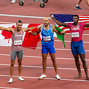 TOKYO, JAPAN August 1:  Lamont Marcell (centre)Jacobs of Italy after winning the 100m Final with Andre de Grasse of Canada who won the bronze medal and Fred Kerley who won the silver medal during the Track and Field competition at the Olympic Stadium  at the Tokyo 2020 Summer Olympic Games on July 31, 2021 in Tokyo, Japan. (Photo by Tim Clayton/Corbis via Getty Images)