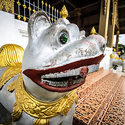 One of two dog sculptures guarding the main stairs at Wat Phonxay Sanasongkham in Luang Prabang, Laos.