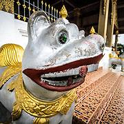 One of two dog sculptures guarding the main stairs at Wat Phonxay Sanasongkham in Luang Prabang, Laos.