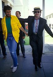 April 18, 2012 - London, England, United Kingdom - GEORGE MICHAEL AND ELTON JOHN BACKSTAGE AT LIVE AID, WEMBLEY STADIUM, 1985. (Credit Image: © Frank Griffin/Avalon via ZUMA Press)