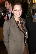 La Vie en Rose in première in theater Tuschinski, Amsterdam. De film kreeg haar wereldpremière als openingsfilm van het prestigieuze Filmfestival van Berlijn.EEn film over het bewogen en gepassioneerde levensverhaal van Edith Piaf.<br /> <br /> Op de foto:  Hoofdrolspeelster Marion Cotillard  <br /> <br /> Actress  Marion Cotill and Director/writer Olivier Dahan attend at the premiere of La Vie en Rose