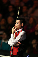 China's Ding Junhui looks on during his match against Neil Robertson of Australia. . Betvictor Welsh Open snooker 2016, day 5 at the Motorpoint Arena in Cardiff, South Wales on Friday 19th Feb 2016.  <br /> pic by Andrew Orchard, Andrew Orchard sports photography.