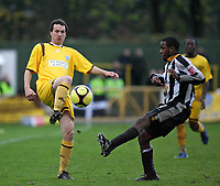 David Hughes (Sutton United) and Myles Weston (Notts County)<br /> Sutton United vs Notts County at The Borough Sports Ground<br /> FA Cup sponsored by E.ON. 1st Round 8/11/2008.<br /> Credit Colorsport / Shaun Boggust