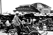 Scene of daily file in front of Center market in Phnom Penh, Cambodia, Asia. Cambodian men ride their cyclo