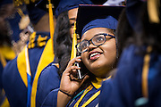 CSF-DC's Bryanna Johnson smiles as she talks with family on the phone during her NC A&T graduation on Saturday, May 14, 2016 (Tigermoth Creative/Chris English)