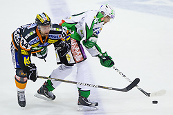 Ziga Pance (HDD Tilia Olimpja, #19) vs Olivier Latendresse (Moser Medical Graz 99ers, #44) during of ice-hockey match between Moser Medical Graz 99ers and HDD Tilia Olimpija in 11th Round of EBEL league, on October 14, 2011 at Eisstadion Graz-Liebenau, Graz, Austria. (Photo By Matic Klansek Velej / Sportida)