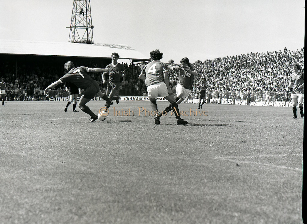 League of Ireland vs Liverpool FC.    (M87)..1979..18.08.1979..08.18.1979..18th August !979..In a pre season friendly the League of Ireland took on Liverpool FC at Dalymount Park Phibsborough,Dublin. The league team was made up of a selection of players from several League of Ireland clubs and was captained by the legendary John Giles. Liverpool won the game by 2 goals to nil..The scorers were Hansen and McDermott...Photograph shows Kenny Dalglish (7) trying to get the ball under control.
