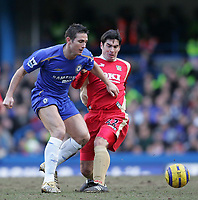 Photo: Lee Earle.<br /> Chelsea v Portsmouth. The Barclays Premiership. 25/02/2006. Chelsea's Frank Lampard (L) battles with Richard Hughes.
