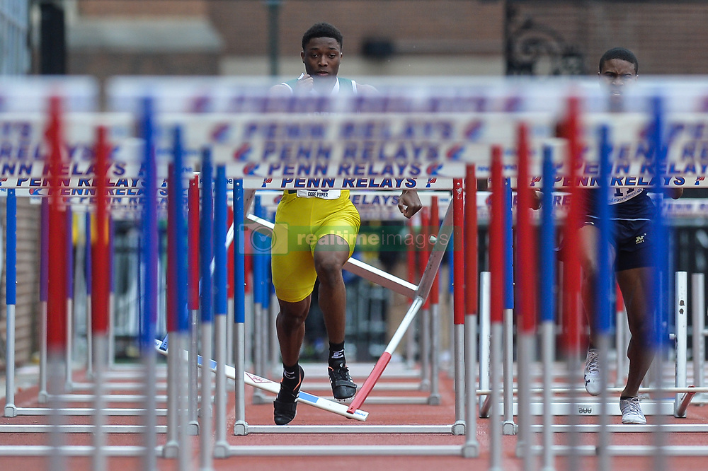 April 27, 2018 - Philadelphia, Pennsylvania, U.S - DEVONTE FINDLAY (20) from Eastern Michigan knocks over the hurdle during the College Men's Shuttle Hurdles 4x110m at Franklin Field in Philadelphia, Pennsylvania. (Credit Image: © Amy Sanderson via ZUMA Wire)
