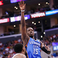 11 May 2014: Oklahoma City Thunder guard Reggie Jackson (15) takes a jump shot over Los Angeles Clippers center DeAndre Jordan (6) during the Los Angeles Clippers 101-99 victory over the Oklahoma City Thunder, during Game Four of the Western Conference Semifinals of the NBA Playoffs, at the Staples Center, Los Angeles, California, USA.